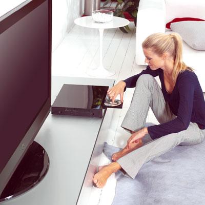 Women enjoying home entertainment system